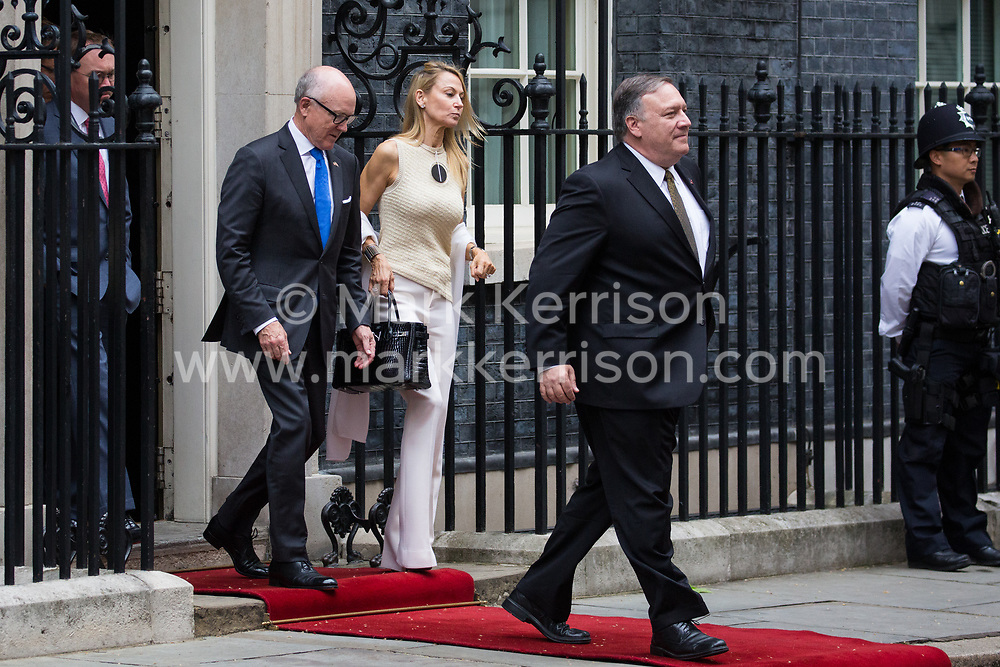 London, UK. 4 June, 2019. US Secretary of State Mike Pompeo (r) and US ambassador Woody Johnson (l) leave 10 Downing Street following lunch and bilateral talks between Prime Minister Theresa May, President Trump and their respective delegations on the second day of the US state visit.