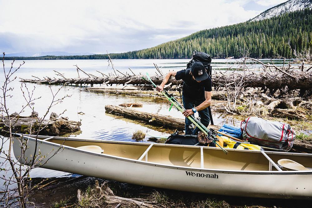 Erme Catino loads up the canoe after skiing the Fallopian Tube, Grand Teton National Park.