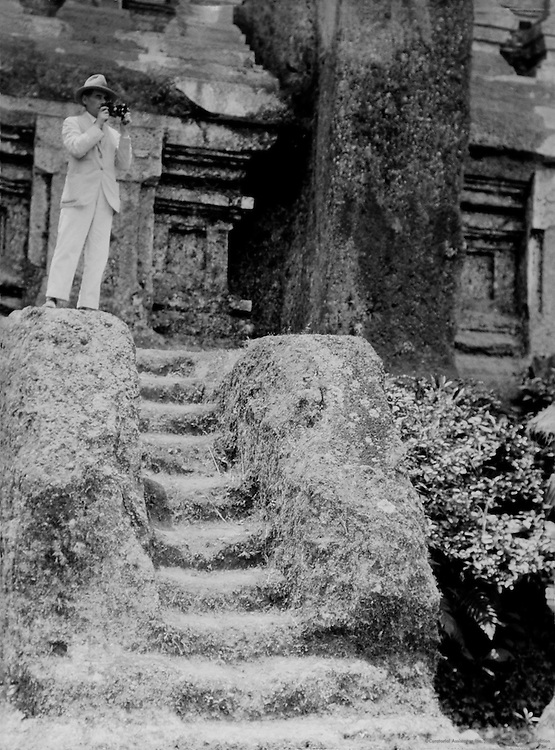 E.O. Hoppé in front of the monument marking the line of the equator, Sumatra, Indonesia, 1930