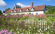 Pretty country cottages and garden at Great Finborough, Suffolk, England