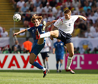 Photo: Chris Ratcliffe.<br /> England v Paraguay. Group B, FIFA World Cup 2006. 10/06/2006.<br /> Steven Gerrard of England clashes with Carlos Peredes  of Paraguay.