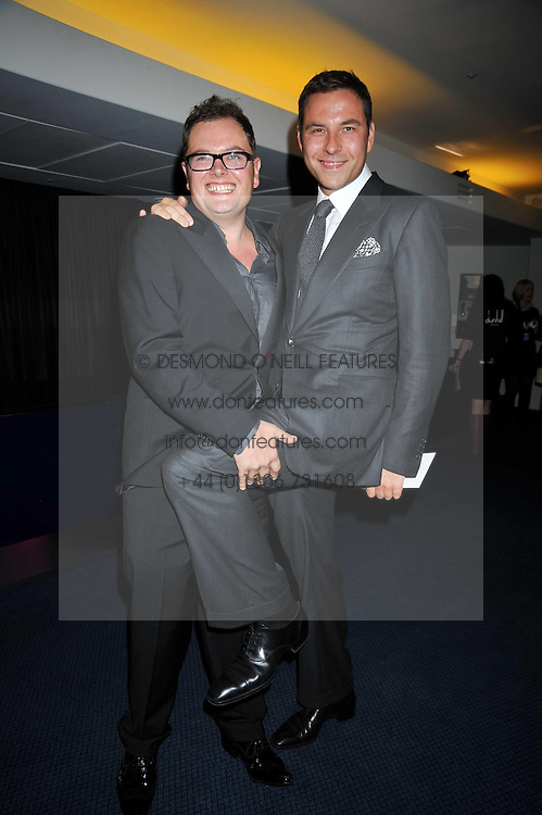 Left to right, ALAN CARR and DAVID WALLIAMS at the annual GQ Awards held at the Royal Opera House, Covent Garden, London on 8th September 2009.