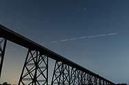 The International Space Station flies over Comet Neowise and the Moodna Viaduct railroad trestle in the Town of Cornwall, N.Y., on July 18, 2020.
