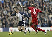 Photo: Aidan Ellis.<br /> Liverpool v Tottenham Hotspur. The Barclays Premiership.<br /> 14/01/2006.<br /> Spurs Teemu Tainio gets away from Liverpool's Momo Sissoko