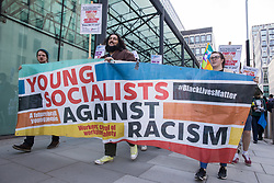 London, UK. 9th October, 2021. Young Socialists take part in a London March for Jobs from the Department for Business, Energy and Industrial Strategy (BEIS) to Downing Street. The march was organised by London Young Socialists and Youth Fight for Jobs, a youth organisation formed in 2009 in response to a rise in youth employment following the 2007-2008 financial crash, to call for decent jobs for young people, a £15ph minimum wage and an end to zero-hour contracts.