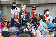 """XR Co-founder Gail Bradbrook delivers a speech during an Extinction Rebellion fifth day of two-week protest campaign outside the Bank of England in London on Friday, Aug 27, 2021.<br /> Activists said that the wealth of this country is """"blood wealth"""" as to this day the country use its financial and armed power to exploit resources elsewhere. (VX Photo/ Vudi Xhymshiti)"""