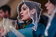 Church choir perform during a service on Christmas eve, in the Saint Gregory the Illuminator Cathedral, in Yerevan, Armenia on Tuesday, Jan 5, 2021. Armenia celebrates Christmas on January 6, adhering to the Armenian Apostolic Orthodox Church. (Photo/ Vudi Xhymshiti)