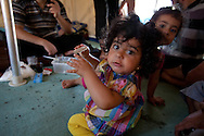 Syrian children eat biscuits in Yayladagi refugee camp, southern Turkey. 11/06/2012