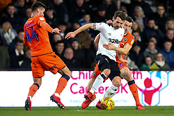 Craig Bryson of Derby County takes on Ben Marshall and Murray Wallace of Millwall - Mandatory by-line: Robbie Stephenson/JMP - 20/02/2019 - FOOTBALL - Pride Park Stadium - Derby, England - Derby County v Millwall - Sky Bet Championship