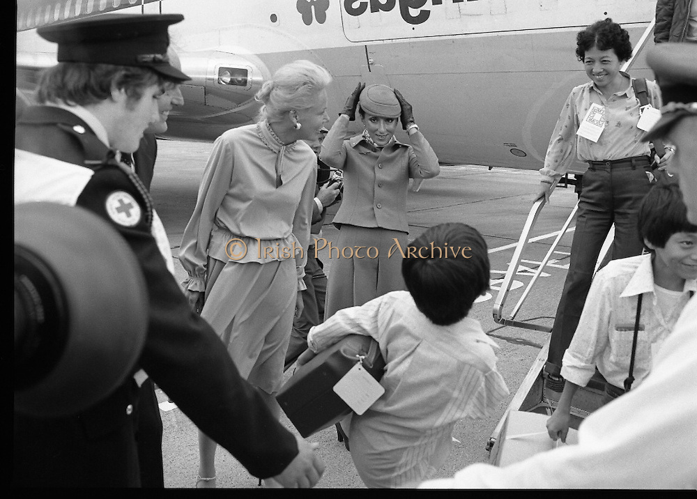 Vietnamese Refugees Arrive In Ireland.   (M85)..1979..09.08.1979..08.09.1979..9th August 1979..As part of an UNHCR initiative, Ireland agreed to take some of the Vietnamese (boat people) refugees into the country. A temporary refugee centre has been set up in the grounds of Blanchardstown Hospital to accomodate the families, from where they will be assimilated into the community..As they disembark the refugees are pictured being met by representatives of the Irish Red Cross.