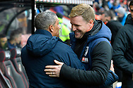 Brighton and Hove Albion manager Chris Hughton and AFC Bournemouth manager Eddie Howe hug before kick off in the The FA Cup 3rd round match between Bournemouth and Brighton and Hove Albion at the Vitality Stadium, Bournemouth, England on 5 January 2019.