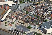 Nederland, Overijssel, Hengelo, 30-06-2011; Centrum van Hengelo met karakteristieke wederopbouw architectuur (het centrum is door bombardementen in 1944 zo goed als vernietigd). Naast het station De Brink en de Schouwburg (het ronde gebouw). De witte overkapping loopt naar de Markt (met Brinktoren). .Center of Hengelo with characteristic post-war architecture (the city centre was almost entirely destroyed during bombing raids in 1944). Next to the station to the Brink with Theater (the round building). The white canopy leads to market square (with Brink Tower)..luchtfoto (toeslag), aerial photo (additional fee required).copyright foto/photo Siebe Swart
