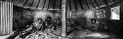 NOUVELLE CALEDONIE, HIENGHENE, Tribu de Cavatch - Kaavac - Les jeune dans le case commune, proche de l'église. De gauche à droite, Jean-Michel Daiju PEI, Hubert Tchoua VAHOU, Florent Wagueno VAHOU, Gregoire Badia VAHOU, Philippe Naout POITHINI - Poteau central en bambou et les murs en pierres maconnees. Aire Coutumiere de Hoot Ma Waap - Aout 2013