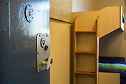 A doorway into an empty cell. Beaufort House, a skill development unit for enhanced prisoners. Part of HMP/YOI Portland, a resettlement prison with a capacity for 530 prisoners.Dorset, United Kingdom.
