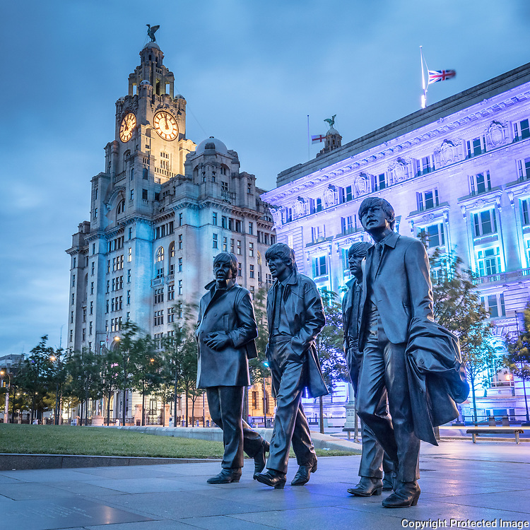The Beatles statue at the Pier Head. Created by sculptor Andy Edwards in 2015 to commemorate the 50th anniversary of their last concert in their home city. Liverpool, Merseyside.