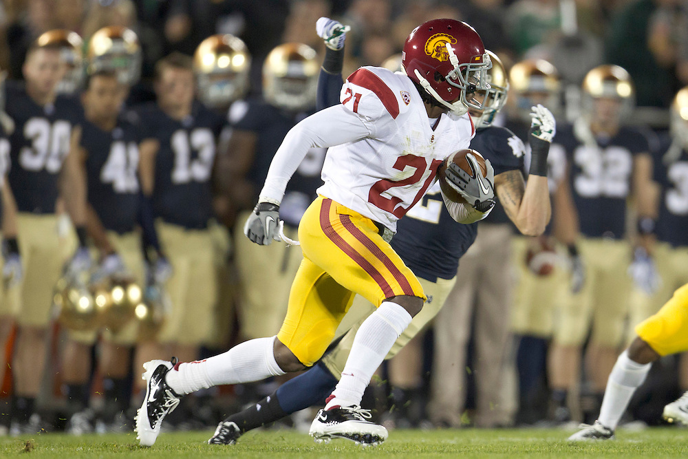 USC cornerback Nickell Robey (#21) runs for yardage during quarter of NCAA football game between Notre Dame and USC.  The USC Trojans defeated the Notre Dame Fighting Irish 31-17 in game at Notre Dame Stadium in South Bend, Indiana.