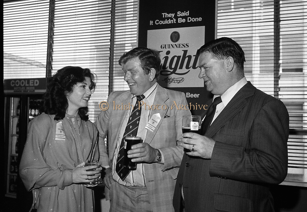"""Guinness Launch """"Guinness Light"""".  (M79)..1979..26.06.1979..06.26.1979..26th June 1979..At the Guinness Theatre in St James Gate Brewery,Guinness launched """"Guinness Light"""". With a spectacular show Guinness brought to the market a new lighter version of its world famous stout. it is hoped that it will fill a niche with younger drinkers frequenting Ireland's pubs and clubs..Marian Mollaghan, G G S I, Mr Feely,Area Manager,Galway and Fergus Hayden, Vice President ,Vitners Federation of Ireland were pictured at the launch of the Guinness Light."""