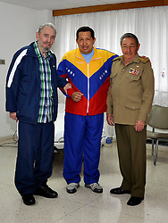 President of Cuba Raul Castro (R), accompanied by the historical leader Fidel Castro (L), talking with the president of Venezuela Hugo Chavez, who is recovering from surgery in a hospital in Habana, Cuba on June 18, 2011. Photo by Photoshot/ABACAPRESS.COM  | 279700_001 Habana Cuba