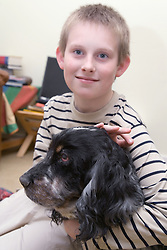 Boy with Autism stroking his pet dog,