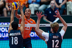 11-08-2019 NED: FIVB Tokyo Volleyball Qualification 2019 / Netherlands - USA, Rotterdam<br /> Final match pool B in hall Ahoy between Netherlands vs. United States (1-3) and Olympic ticket  for USA / (L-R) Garrett Muagututia #18 of USA, Nimir Abdelaziz #14 of Netherlands, Maxwell Holt #12 of USA