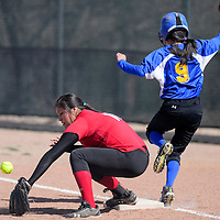 032615       Cable Hoover<br /> <br /> Zuni Thunderbird Shanay Edaakie (9) tags up on first as the ball bounces past St. Michael Cardinal Desiree Thomas (10) Thursday at Tohatchi High School.