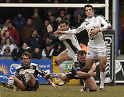 Bristol, ENGLAND, 12.03.2006,  Gonzalo Tiesi, tackles by Dave Hilton, Craig Short sitting [left] and Riki Flutey, breaks left, as Bristol  Rugby vs London Irish, in a round of the Guinness Premiership, on Sunday 12th, © Peter Spurrier/Intersport-images.com..   [Mandatory Credit, Peter Spurier/ Intersport Images].