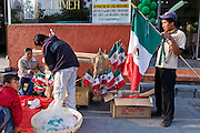 16 SEPTEMBER 2005 - MEXICO CITY: Vendors sell Mexican flags at the Independence Day parade in Mexico City, Sept. 16. Mexico celebrated its 195th Independence Day in 2005 with a huge military parade through the center of Mexico City.  PHOTO BY JACK KURTZ