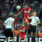 Turkey's Egemen KORKMAZ (L) and Germany's Benedikt HOWEDES (R) during their UEFA EURO 2012 Qualifying round Group A matchday 19 soccer match Turkey betwen Germany at TT Arena in Istanbul October 7, 2011. Photo by TURKPIX