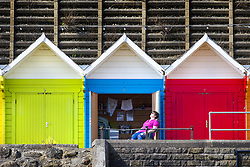 April 18, 2018 - Scarborough, Yorkshire, UK - A lady sunbathes outside her beach hut on Scarborough beach this morning as the country prepares for more warm weather. (Credit Image: © Andrew Mccaren/London News Pictures via ZUMA Wire)