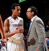CHARLOTTESVILLE, VA- NOVEMBER 26:  Darion Atkins #32 of the Virginia Cavaliers talks with Virginia Cavalier assistant coach Jason Williford during the game on November 26, 2011 at the John Paul Jones Arena in Charlottesville, Virginia. Virginia defeated Green Bay 68-42. (Photo by Andrew Shurtleff/Getty Images) *** Local Caption *** Darion Atkins;/Jason Williford