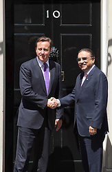 © Licensed to London News Pictures. LONDON, UK  01/07/11. The President of Pakistan, Asif Ali Zardari, shakes the hand of British Prime Minister David Cameron at the door to 10 Downing Street in London today (Friday). Talks between Mr Cameron and Mr Zadari are expected to discuss allied troop withdrawals from Afghanistan and security on the Afghanistan/Pakistan border.  Please see special instructions for usage rates. Photo credit should read Matt Cetti-Roberts/LNP