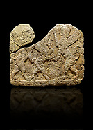 Photo of Hittite relief sculpted orthostat stone panel of Herald's Wall Limestone, Karkamıs, (Kargamıs), Carchemish (Karkemish), 900-700 B.C. Anatolian Civilisations Museum, Ankara, Turkey.<br /> <br /> Two sphinxes standing on their hind legs on both sides attack to the winged horse standing on its hind legs in the middle.  <br /> <br /> Against a black background. .<br />  <br /> If you prefer to buy from our ALAMY STOCK LIBRARY page at https://www.alamy.com/portfolio/paul-williams-funkystock/hittite-art-antiquities.html  - Type  Karkamıs in LOWER SEARCH WITHIN GALLERY box. Refine search by adding background colour, place, museum etc.<br /> <br /> Visit our HITTITE PHOTO COLLECTIONS for more photos to download or buy as wall art prints https://funkystock.photoshelter.com/gallery-collection/The-Hittites-Art-Artefacts-Antiquities-Historic-Sites-Pictures-Images-of/C0000NUBSMhSc3Oo