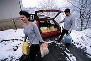 (MODEL RELEASED IMAGE). Although their complicated schedules put pressure on their lives, Rasim and Ensada Dudo of Sarajevo still try to preserve the rituals and pleasures of eating. Remembering all too well when the city was starving, they are grateful that they can now fill Rasim's taxi with the weekly grocery shopping. Hungry Planet: What the World Eats (p. 50).