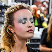 Exhibitor and make-up artists from around the world demo at IMATS London on 18 May 2019,  London, UK.
