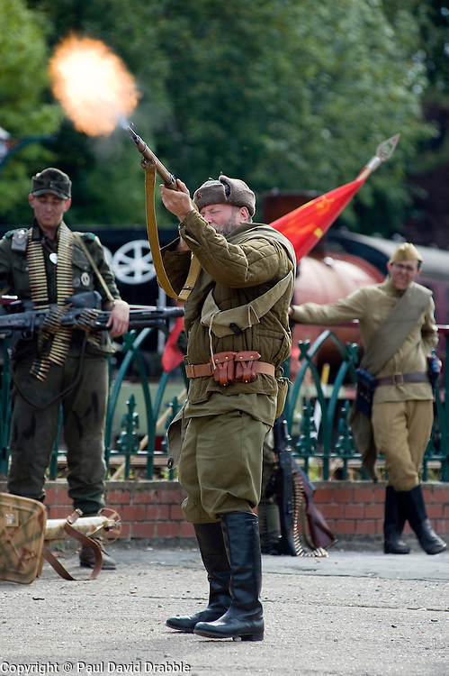 A re-enactor dressed as a Soviet soldier from the Russian 13th Guards Rifle Division takes part in a living history firing display at the Elsecar Heritage Centre 1940s Weekend<br /> 4 September 2010<br /> Images © Paul David Drabble..