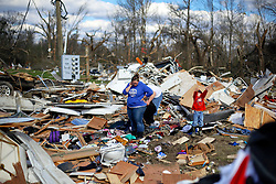 24 February 2016. Sugar Hill RV Park, Convent, Louisiana.<br /> Scenes of devastation following a deadly EF3 tornado touchdown. 2 confirmed dead. <br /> Meagan Thomas, Zachary Brown and their 4 yr old son Garrett recover all they can from their destroyed trailer.<br /> Photo©; Charlie Varley/varleypix.com