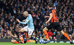 Shakhtar Donetsk's Taras Stepanenko (left) brings down David Silva in the box, resulting in a penalty during the UEFA Champions League match at the Etihad Stadium, Manchester.