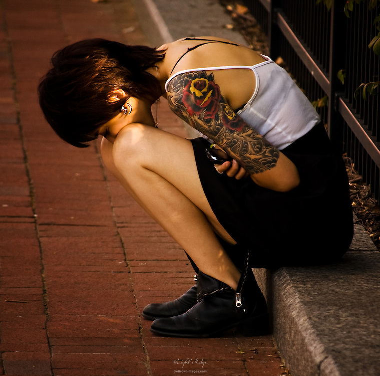 A young lady ponders during the Wilmington, DE Riverfront Blues Festival.