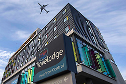 © Licensed to London News Pictures.13/02/2021, London, UK. An airplane flies over a Travelodge Hotel as it departures from Heathrow Airport in West London. Arriving passengers from 22 'red list' countries will need to quarantine in hotel rooms to prevent a new spread of the coronavirus from Monday. Photo credit: Marcin Nowak/LNP