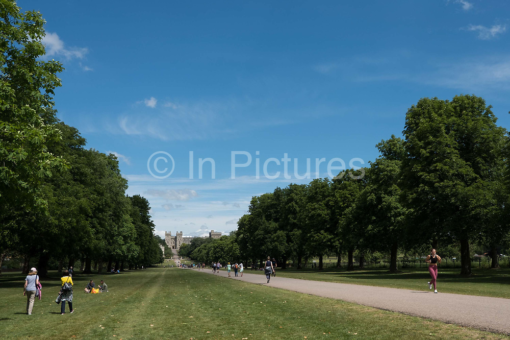Local residents and visitors enjoy some exercise on the Long Walk in Windsor Great Park on 13th June 2020 in Windsor, United Kingdom. Lockdown restrictions implemented in order to reduce infection from COVID-19 continue to be eased by the British government and pressure has been building for a reduction in the two-metre physical distancing rule to be considered.