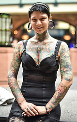 © licensed to London News Pictures. 26/9/2014<br /> The 10th London International Tattoo Convention, one of the most prestigious body art conventions in the world, brought together 400 of the best tattoo artists to thousands of admirers at Tobacco Dock. Other attractions and alternative performances included burlesque, sword swallowing, striptease dancers, fire-dancers and trapeze performers. Pictured. Performer Aima Indigo from Mexico.<br /> Photo credit : Ian Whittaker/LNP