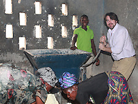 Today marks the 25th annive Jonathan Ross visits the African Women's Development Fund in Accra, Ghana. Jonathan Ross trying his hands on the milling machine assisted by Elizabeth Teman and Comfort Zormelo. Jonathan Ross is in Ghana with Comic Relief to mark the 25th anniversary of Red Nose Day. Thirteen Red Nose Days later it has raised over £600million and over the last 25 years that money will have helped 50 million people across Africa, the world's poorest countries and here in the UK. Keep up the good work. rednoseday.com ©Christian Thompson
