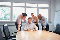 Multi-racial Group conference room teamwork table