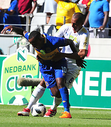 Cape Town--180401  Mamelodi Sundowns defender Wyne Arendse  challenges by Ayanda Patosi  of Cape Town City during the Nedbank Cup quarter final game at the Cape Town Stadium.Sundowns won the game 2-1 and will play maritzburg in the Semi-final  .Photographer;Phando Jikelo/African News Agency/ANA