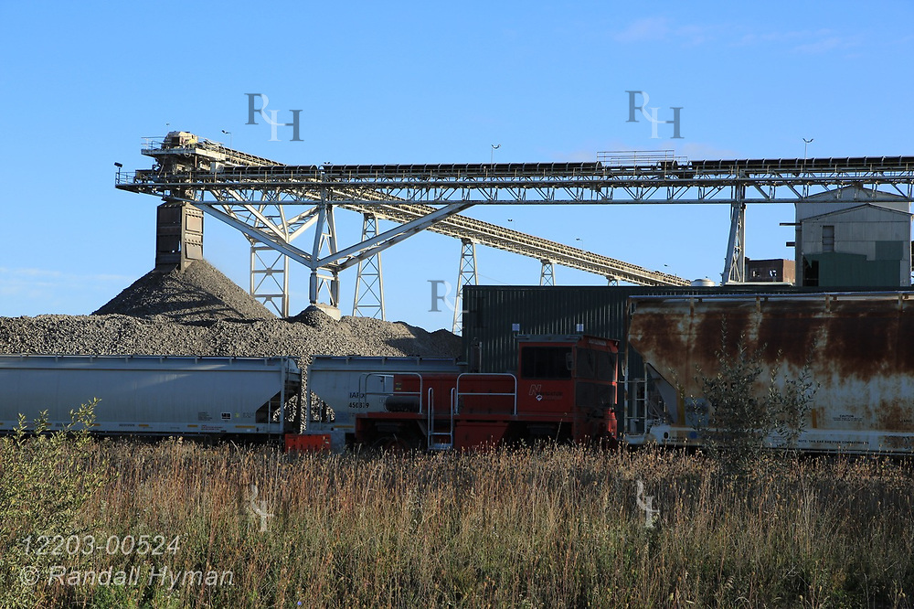 Railcars and belt conveyors move materials at Lafarge Cement Plant; Alpena, Michigan.