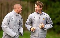 Photo: Daniel Hambury.<br />West Ham Utd Training. 03/11/2005.<br />Paul Konchesky (L) and Teddy Sheringham share a joke during training.