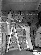 03/06/1954<br /> 06/03/1954<br /> 03 June 1954<br /> Kellogg's factory at Terenure, Dublin. Image shows cases of Corn Flakes being moved from the store room at the factory.