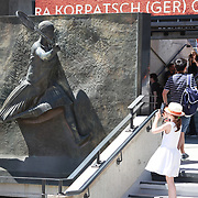 2017 French Open Tennis Tournament - A young tennis fan photographs the statue of Suzanne Lenglen in front of Suzanne Lenglen Stadium during the qualifying rounds of the French Open Tennis Tournament at Roland Garros on May 25th, 2017 in Paris, France.  (Photo by Tim Clayton/Corbis via Getty Images)