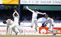 November 23, 2018 - Colombo, Sri Lanka - Sri Lankan cricketers Niroshan Dickwella, Dananjaya de Silva and Kusal Mendis appeal during the 1st day's play in the 3rd and final test cricket match between England and Sri Lanka at SSC international cricket stadium, Colombo, Sri Lanka. 11-23-2018  (Credit Image: © Tharaka Basnayaka/NurPhoto via ZUMA Press)