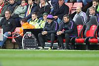 Football - 2018 / 2019 Premier League - Southampton vs. Tottenham Hotspur<br /> <br /> Tottenham goalkeeping coach using his mobile phone pitch side at St Mary's Stadium Southampton<br /> <br /> COLORSPORT/SHAUN BOGGUST